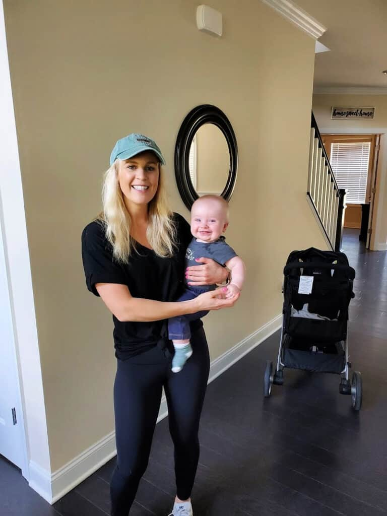 Lindsey holding Jacob before a walk