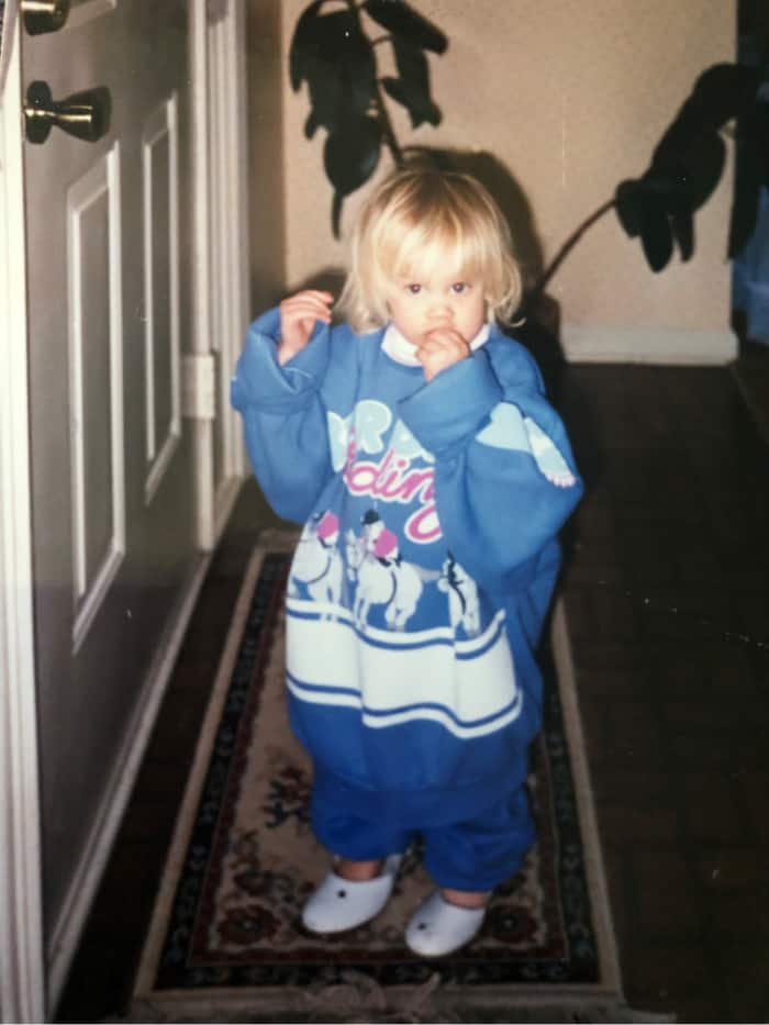 Lindsey in a giant sweater as a toddler