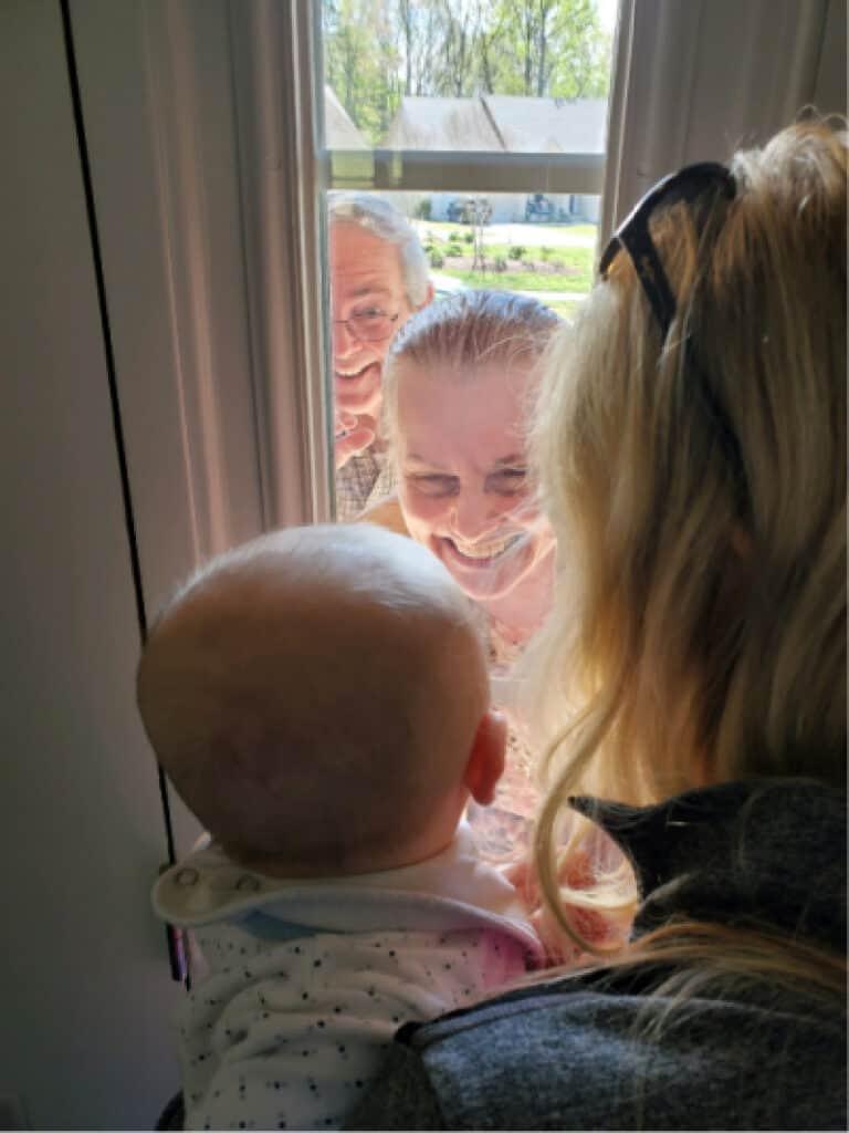 Jacob looking at his grandparents through the front door window