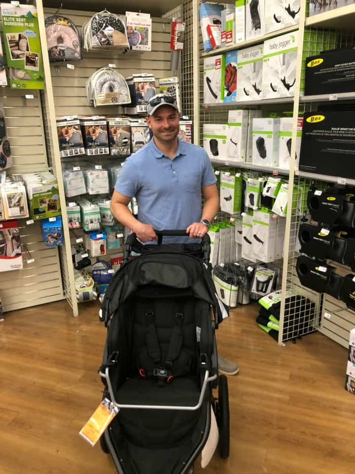 Joey pushing a stroller at Buy Buy baby