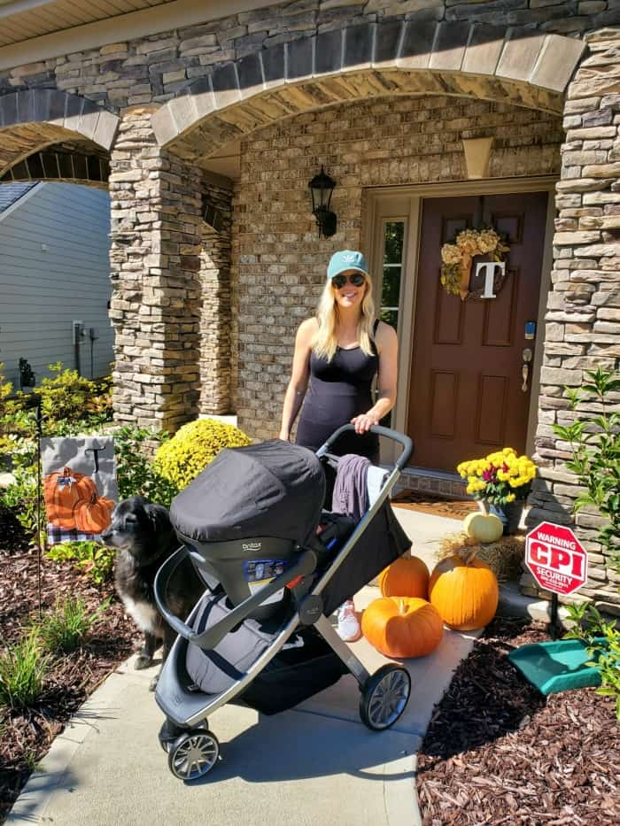 Lindsey by the front porch with the stroller about to head out for a walk