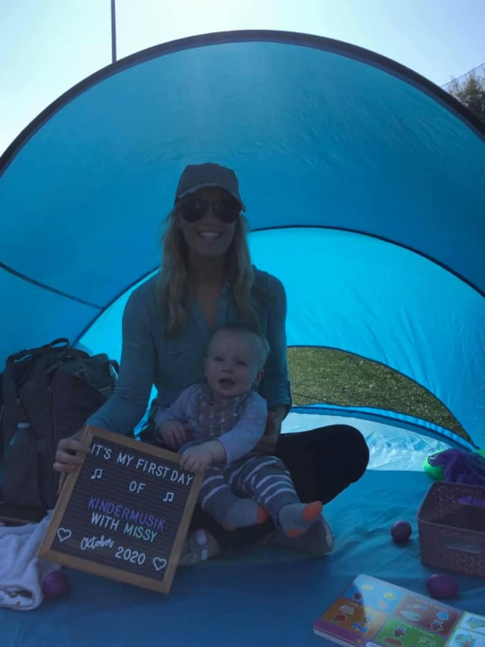 Jacob and Lindsey in their blue tent on their first day of Kindermusik class outdoors.