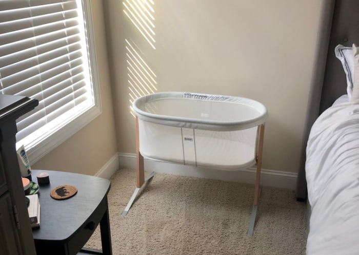 Jacob's bassinet set up next to the bed