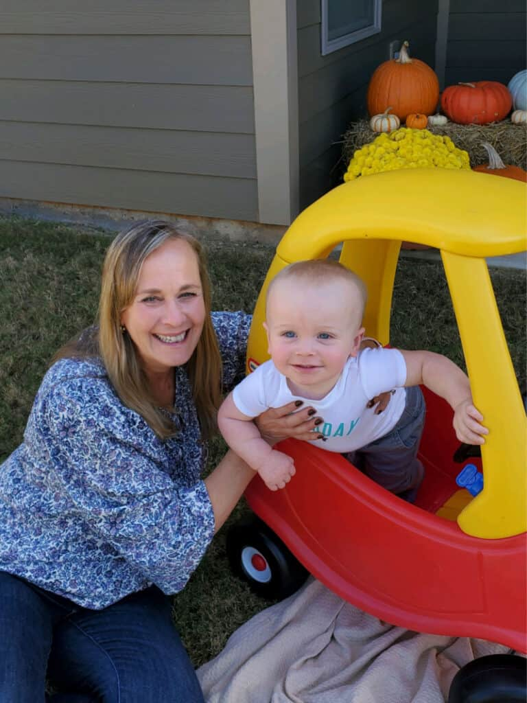 Grammy and Jacob as he smiles in his car.