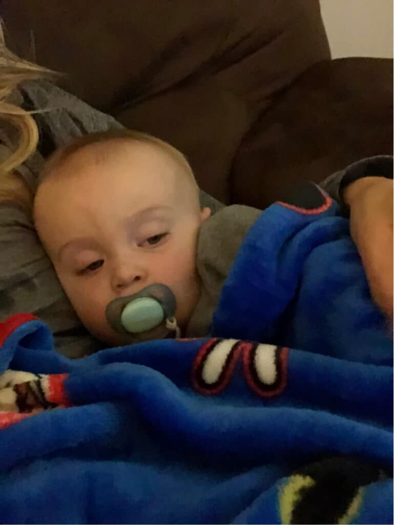 Jacob snuggled up with Lindsey watching cartoons.
