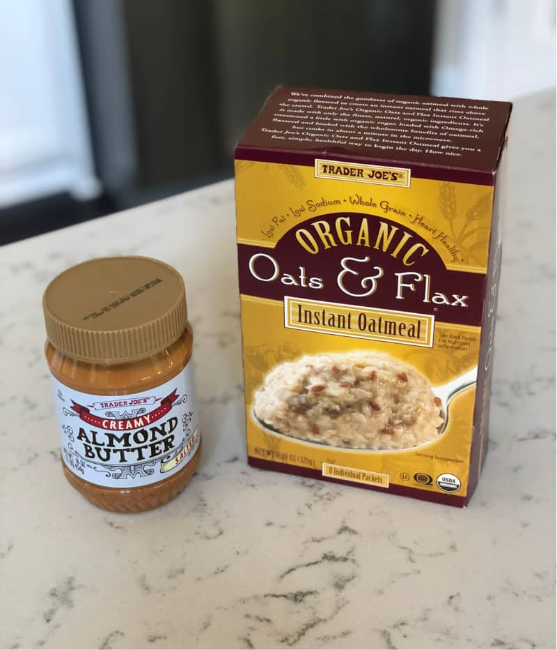 Can of creamy almond butter and a box of instant oatmeal