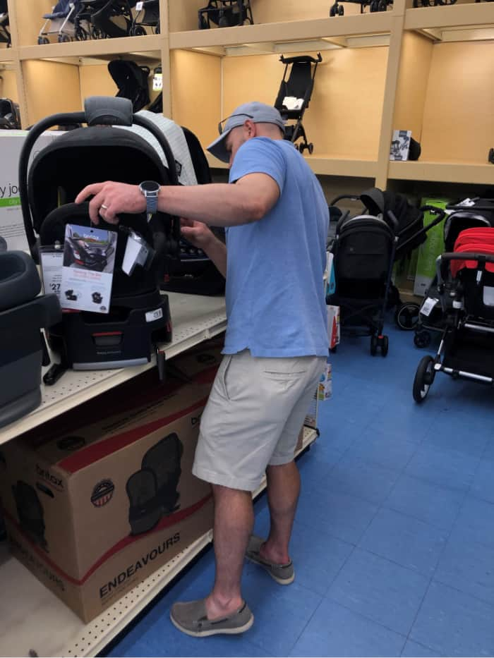 Joey shopping for car seats at BuyBuy baby.