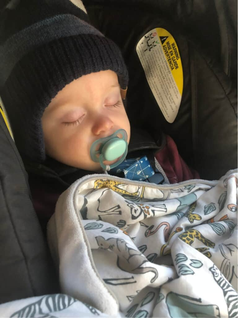 Jacob asleep in his carseat.