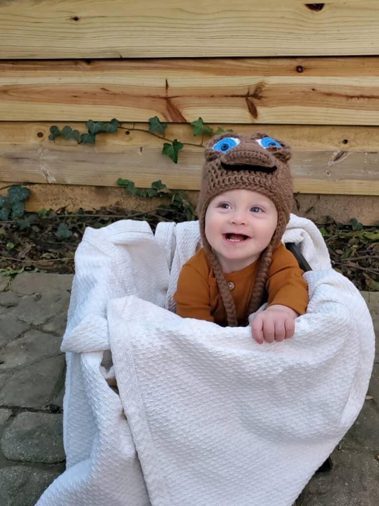 Jacob smiling in his alien hat