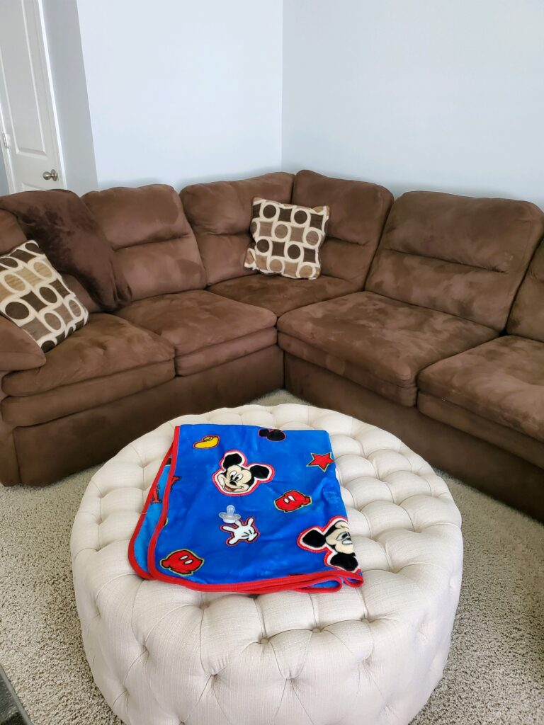 The ottoman and couch.