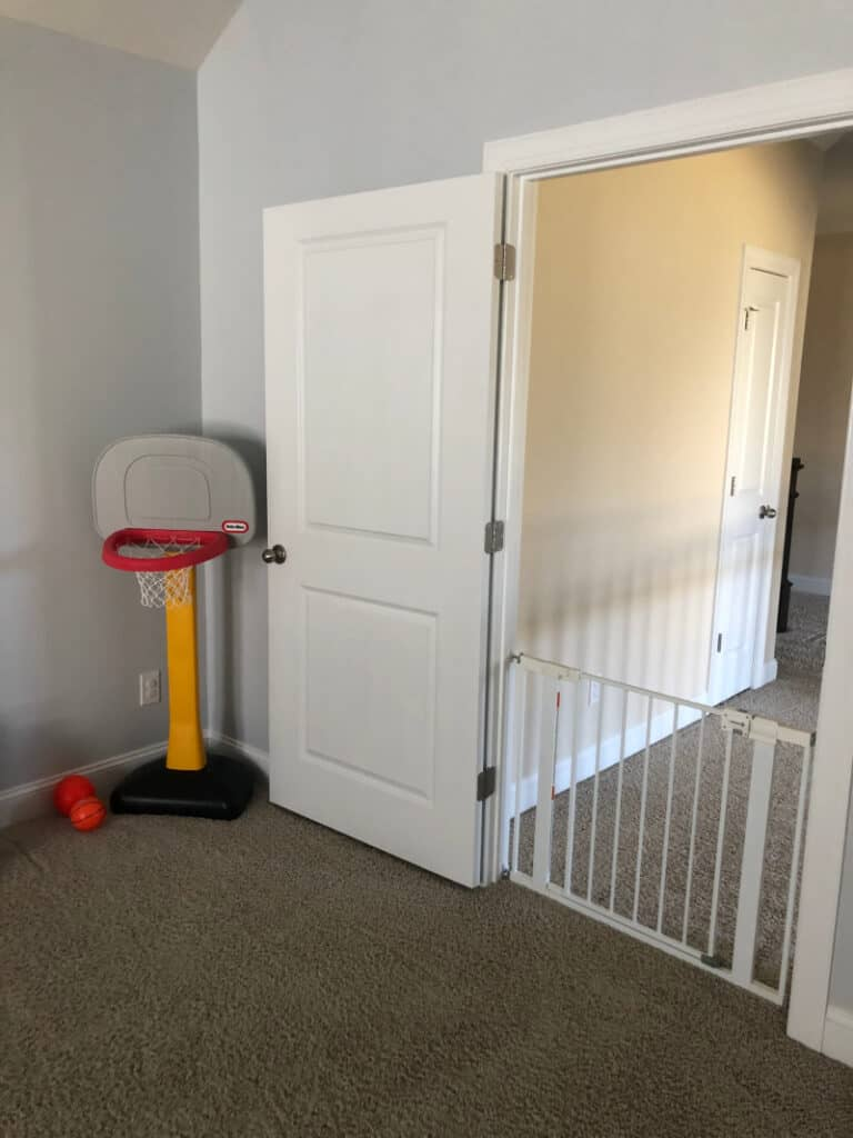 The kid basketball goal and baby gate.
