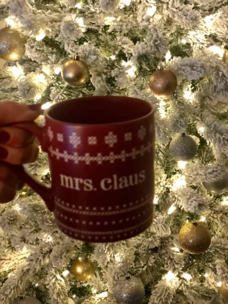 Mrs. Claus coffee mug in front of the Christmas tree