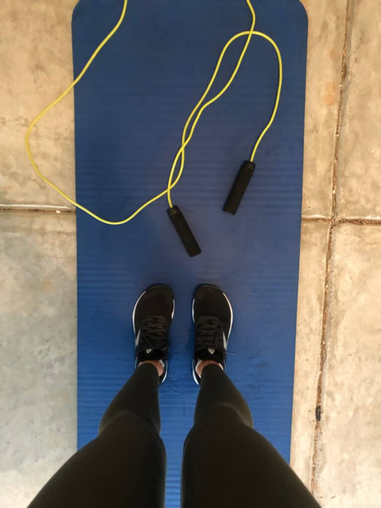 Jump rope and yoga mat in the garage