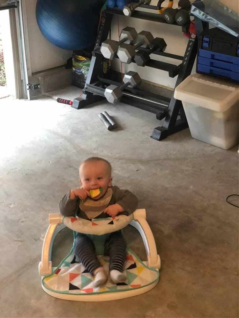 Jacob in his sit me up chair in the garage