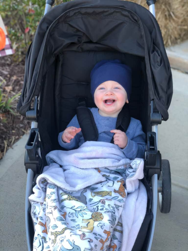 Jacob smiling in the stroller.