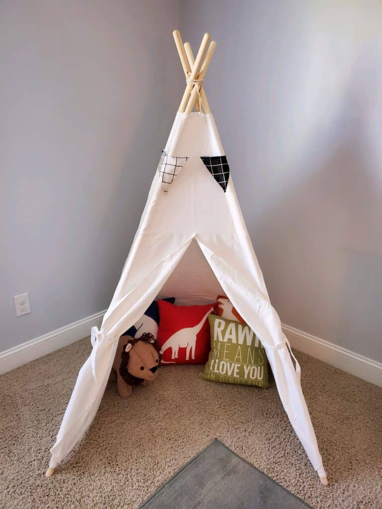 The play tent with pillows.