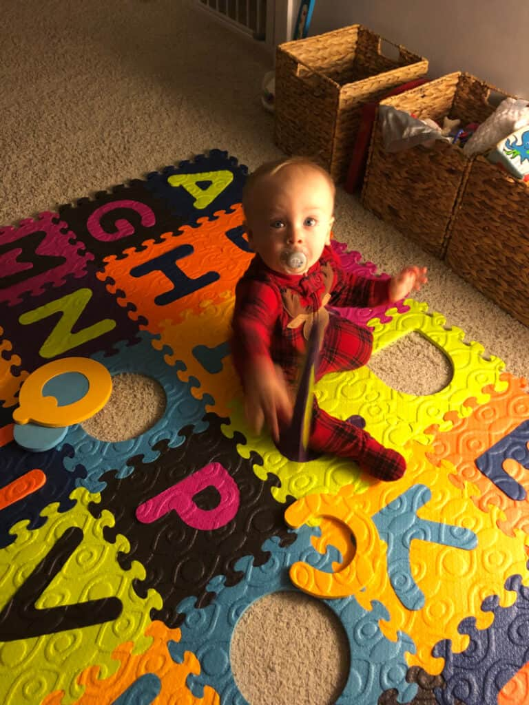 Jacob throwing his alphabet letters.