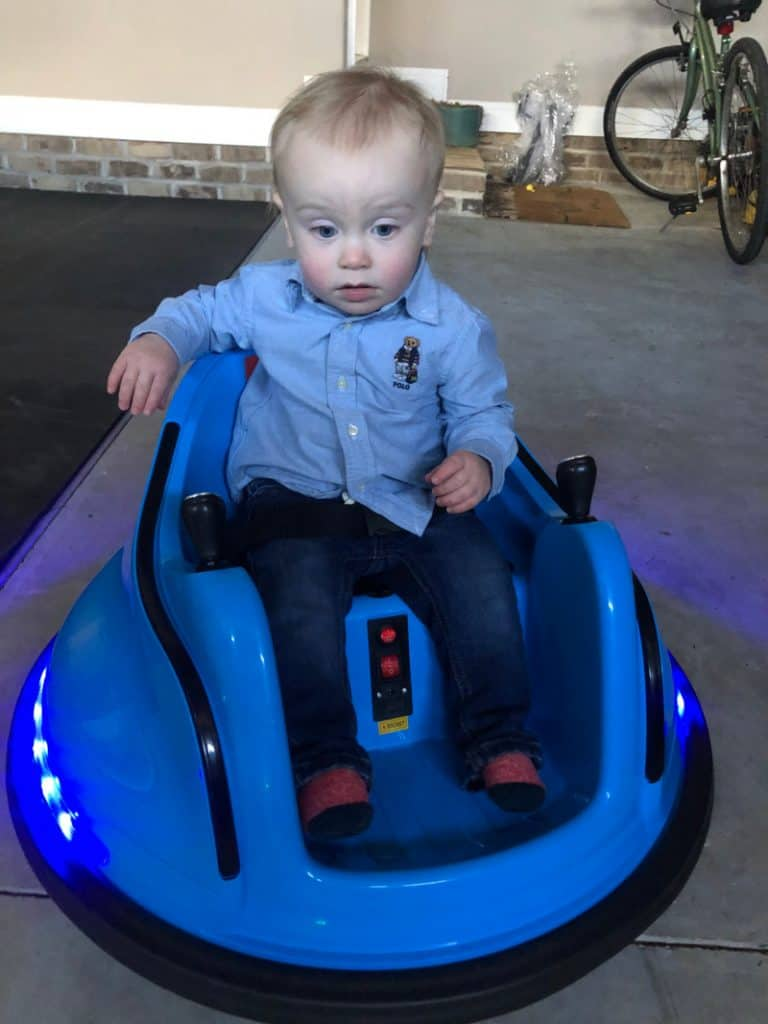 Jacob looking worried on a bumper car