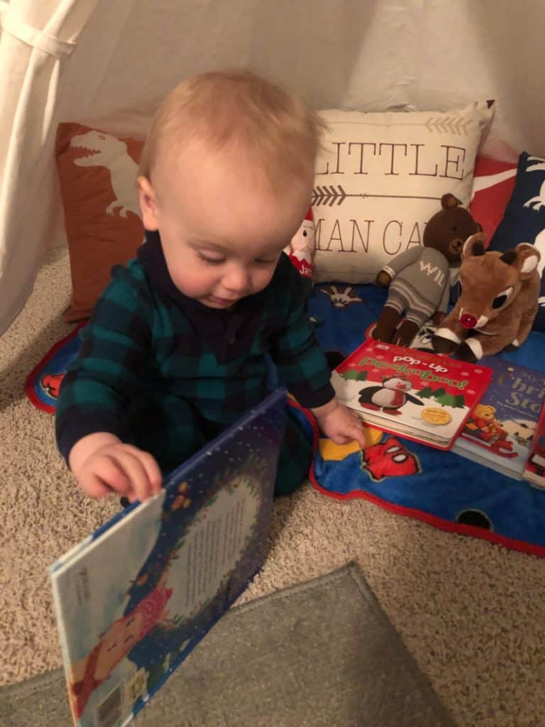 Jacob opening a Christmas book.
