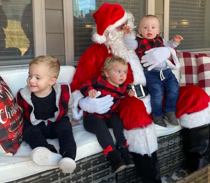 The babies sitting next to Santa