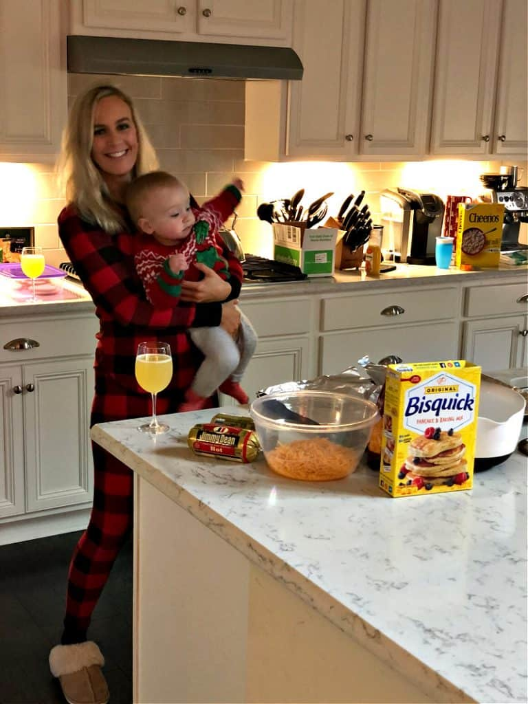 Lindsey holding Jacob in the kitchen as he squirms