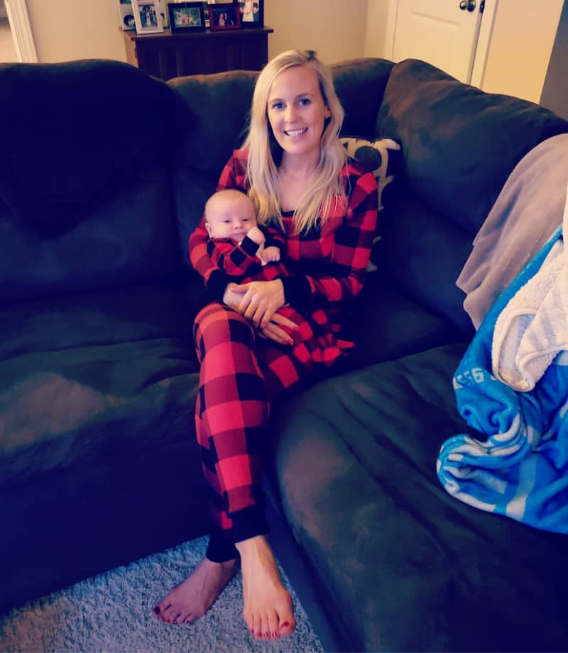 Lindsey holding Jacob on the couch in matching pajamas
