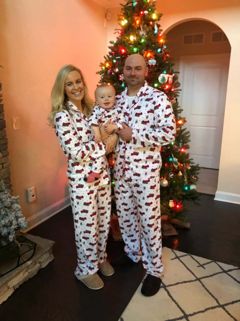 Family pajama pic standing by the tree