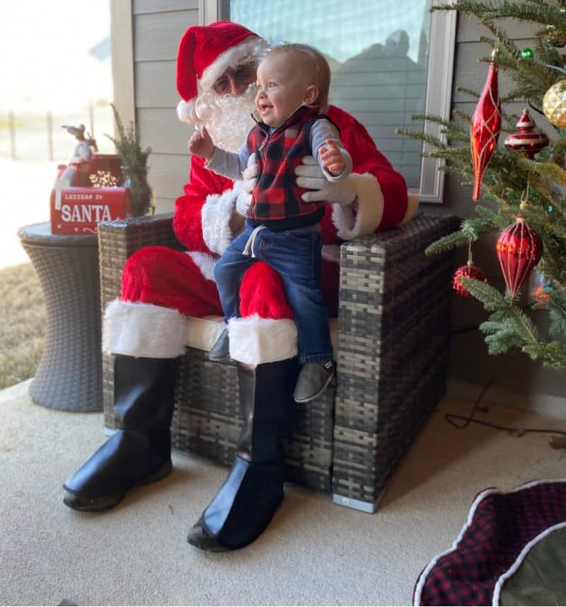 Jacob smiling on Santa's lap