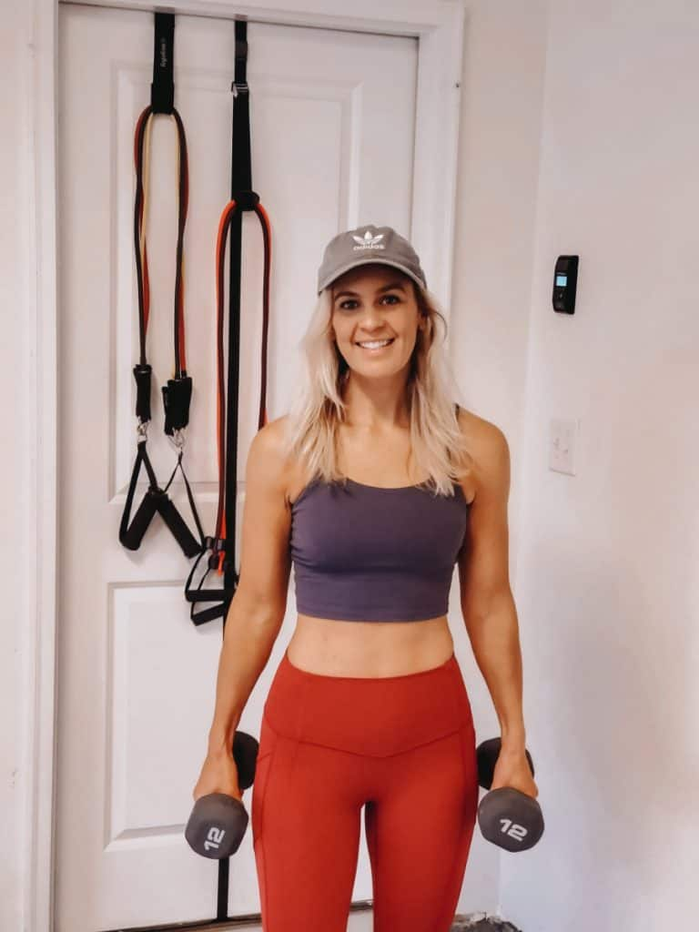 Lindsey in workout clothes holding weights